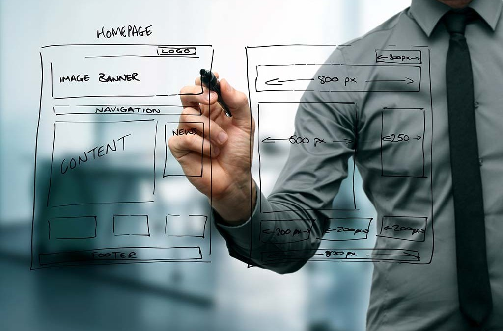 Man creating a mockup to redesign a website